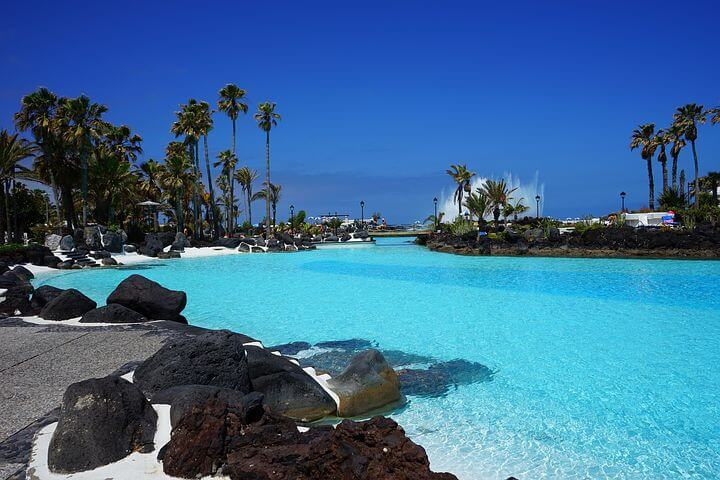 Swimming pool with tropical garden in Tenerife, fun place for kids